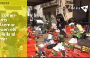 Els comerciants d'Asemar treuen els taulells al carrer